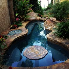 Dream hot tub complete with water feature, fire pit and outside shower (inspiration: family beach house)