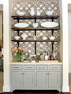 Open Shelving - Best New Kitchen - Southernliving. The first accessory selected for the space was a collection of antique ironstone china. The pieces are displayed on rustic, wooden open shelves supported by extra-long iron brackets. Kitchen Wallpaper, Wallpaper Cabinets, Cafe Bar, Southern Living, Interior Design Kitchen, Open Shelving, New Kitchen, Kitchen Ideas, Home Kitchens