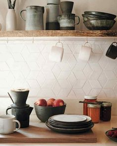 Cain's stoneware, shown here, consists of necessary tools for their daily routine, including coffee-brewing. The countertops are quartz composite from a local company. Cain learned how to fire the ceramic tiles herself to form the geometric backsplash. Kitchen Inspirations, White Kitchen Backsplash, Kitchen Remodel, Kitchen Decor, New Kitchen, Trendy Kitchen Backsplash, Home Kitchens, Kitchen Tiles, Shabby Chic Kitchen