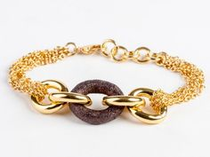 #Pulsera elaborada con #Acero y #Bronce en un #original conjunto de tonalidades doradas. #Jewelry #Fashion #Stile #Bracelet #Steel #Joyas #thebestgift #elmejorregalo #meencanta #iloveit #Qillqa