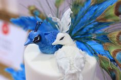 white and blue peacocks wedding cake detail