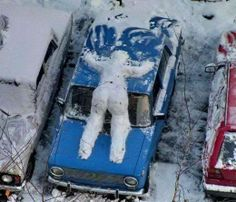 Snowcat 203 Snowperson on car