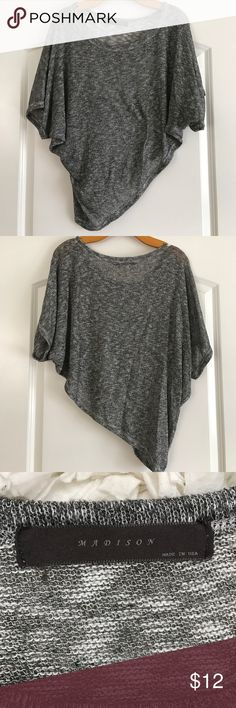 """French Terry Asymmetrical Knit Top Adorable short sleeve heather gray top. Asymmetric hem. Can be worn off the shoulder. Made for loose fit. Hangs right on body. Made with French terry fabric. Batwing short sleeves. Length it the center 20"""". Pit to pit 35"""". Madison Tops Crop Tops"""