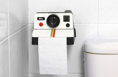 Love this polaroid-themed toilet paper holder. Get instant paper! | Polaroll