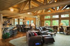 I love how open this is but also how the carpet meets the wood flooring. The great room features two structural log trusses and log purlins. White cedar log finish and paneling are throughout. The room is open to the kitchen and dining area. Future House, My House, Cedar Homes, Log Cabin Homes, Log Cabins, Timber House, Belle Photo, Great Rooms, My Dream Home