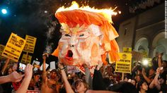 """Protesters set an effigy of Donald Trump afire outside Los Angeles City Hall on Wednesday, November 9. <a href=""""http://www.cnn.com/2016/11/10/politics/election-results-reaction-streets/index.html"""">Tens of thousands rallied in at least 25 US cities</a> to protest Trump's unexpected victory in the divisive 2016 presidential election."""