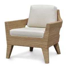 CAPE TOWN LOUNGE CHAIR by PALECEK Rattan pole frame wrapped with fine natural abaca rope. The simple silhouette features two cut out holes that add visual interest. Upholstered seat.