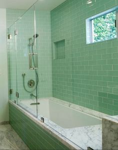 Green Lush glass subway tile paired with this gorgeous marble inspire thoughts of revitalization and renewal! Tile available at www.modwalls.com