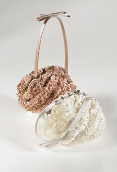 Sondra Roberts ribbon ruffle pouch handbag features:  Inner pocket • Kiss lock closure • Attached handle\strap.