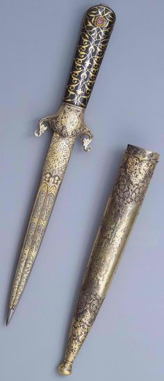 Indo-Persian double edged dagger, Persian blade, Ottoman sheath, blade 2nd half of the 16th century, sheath 17th century, steel, silver, gold, uncut diamonds, rubies. Dimension: l. 21,5 cm, Hermitage Museum, Russia.