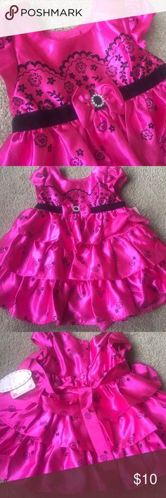 Jona Michelle Pink Satin Black Formal Dress 18m Gorgeous special occasion dress for your little angel. 18 month brand new with tags. Gorgeous detailing. Lace like upper design with cute bow. Tutu underskirt. Perfect for photo / photo shoots, weddings, special occasions, birthdays. Jona Michelle Dresses Formal