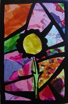 'Stained Glass'. Cut out from black card, tissue paper pieces glued to wax paper behind cut outs.