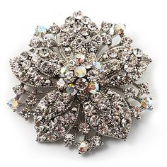 $28.38 Add a chic finishing touch to your outfit with this glamour Victorian Corsage Flower Brooch. The silver-tone brooch is decorated with an eye-catching combination of iridescent and clear crystals set in the shape of a beautiful flower. It measures about 55mm x 55mm and fastens with a flag pin and revolver. Please note, this brooch comes with clear crystals only! The AB crystals that are visible in the pictures are, in fact, clear crystals...