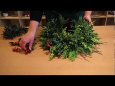 """▶ OASIS® Floral Products ~ How To ~ A Christmas Wreath - YouTube [Oasis did such a great job showing how to place greens - they concept applies to any vase designs also using floral foam] Go ahead and watch it.  Your deign can be more basic.  This design was from UK and too """"busy"""" I feel.  But overall great video on floral design basics."""