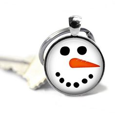 """Christmas Key Chain - Snowman Key Chain - Christmas Jewelry - Christmas Keychain - Stocking Stuffer - Snowman Pendant - Whimsical Gift. Snowman Key Chain - Handcrafted round pendant measures 1 inch across (25mm) and has been created using a shiny silver or antique bronze tone bezel. Artwork has been sealed under a non-yellowing, scratch resistant, high gloss epoxy bubble which enhances the image. The pendant comes with a matching key ring. The entire key chain measures 2.5"""" long. Water..."""