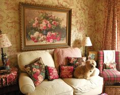 Brambly: Wallpaper. I like the colors, pillows and painting.