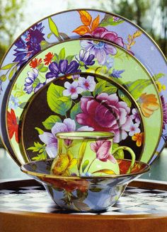 A vibrant bouquet of flowers blossoms on an enameled steel charger, hand decorated to create the ideal touch of color on a summertime table MacKenzie-Childs Flower Market Charger afflink Mckenzie And Childs, Breakfast Plate, Deco Boheme, Flower Market, China Patterns, Home Living, Plate Sets, Tea Set, Decoration