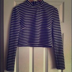 Black and white stripped turtle neck crop top Perfect condition , only worn  twice . Has a ribbed feeling. Super stretchy and zipper in the back . Perfect with some hi waisted jeans . Forever 21 Tops Crop Tops