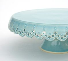 Lovely, robin's egg blue lace cake stand just needs a coconut cake set upon it.