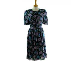 """80s Floral Multicoloured Dress Features a large floral print in purple, lilac, yellow, blue, green and black #80sdress #vintagefashion #vintage #retro #vintageclothing #80s #1980s #vintagedress <link rel=""""canonical"""" href=""""http://www.blue17.co.uk/>"""