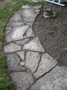 Stepping stone walkway to go around deck and into woods