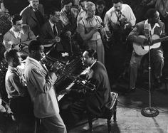1943. In the 40s Jazz was a very popular genre. The picture shows a popular jazz artist, Duke Ellington, performing.
