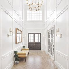 Some Saturday inspiration for all my beautiful peeps! I mean ....this FOYER!? The detailed molding on the walls...the herringbone floor...that CHANDELIER!? I think that mixing up how to wood or tile is laid makes such a huge impact on any space. Can easily make a design go from drab...to FAB!  •  Design by @the_fox_group_   Every single thing they touch is timeless and classic and absolutely stunning! One to follow!  •  •  •  •  •  #entrywaydecor #entryway #entry #whiteoak #foyer #tr