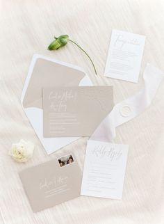 White and taupe wedding invitation: http://www.stylemepretty.com/2016/11/15/a-white-on-white-wedding-design-made-for-the-classic-couple/ Photography: KT Merry - https://www.ktmerry.com/