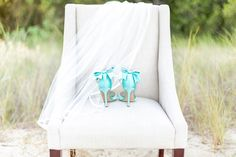Tiffany blue bridal shoes with bows | Lauren Werkheiser Photography | see more on: http://burnettsboards.com/2016/02/beach-wedding-unique-color-palette/
