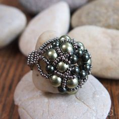 This listing is for a PDF file containing instructions for making the Dorothy Ring, not the ring itself. The beading pattern is very detailed. Step by step with illustrations of each step, material list, color list, and finished pictures of the ring. Beadwork pattern for beginners to