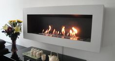 Bio Ethanol Fireplaces For Wall Mounted Applications . Come and find out how with a Wall Mounted Bio Ethanol Fireplace you can redecorate your home and at the same time save money on heating. Gel Fireplace, Wall Mounted Fireplace, Fireplace Inserts, Modern Fireplace, Living Room With Fireplace, Fireplace Design, Biofuel Fireplace, Bioethanol Fireplace, Ideas