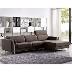"Ardmore Modern Sectional Sofa  This handsome modern brown fabric sectional sofa set features a sturdy rectangular stainless steel base with high density cushioned seats and backs for better-quality support and comfort.  Sectional Pieces:    	Sofa: Width: 75"" - Back To Front: 41"" - Height: 25"" 	Chaise: Width: 43"" - Back To Front: 70"" - Height: 25""   Features:    	Brown fabric upholstery 	Sturdy rectangular stainless steel base 	High density cushioned seats and backs for better quality support…"