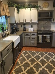 stained concrete covering counters, painted cabinets, new hardware, tile backsplash
