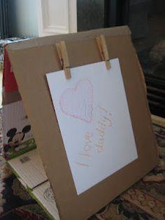 DIY art easel from a cardboard box.