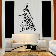 African Woman Wall Decal Art. This would be great on one of the walls in the living room with a mirror and end table on either side of the painting.