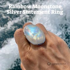 This gorgeous Moonstone ring shines rainbow pastel colors that will brighten up your day! This statement ring comes in a Size 10 with adjustable band so you'll always have the perfect fit. Tap the photo to get this one of a kind ring today and see the other statement rings available at crystalrockstar.com Crystal Jewelry, Gemstone Jewelry, Rainbow Pastel, Los Angeles Shopping, Ethical Shopping, Crystal Fashion, Moonstone Ring, Crystals And Gemstones, Rainbow Moonstone