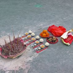 Ritualistic food offerings and incense burning at the hungry ghost festival…