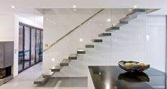 RoomStone® – exclusive fair-faced concrete products, self-supporting cantilevered staircase, cantilevered stairs, folded plate staircase, folded plate staircase