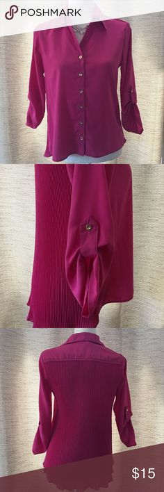 Magenta blouse Beautiful magenta button down blouse with button up 3/4 length sleeves, golf button details, and a beautiful accordion pleated back. Tops Blouses