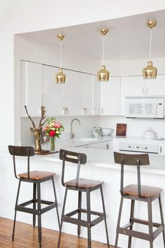 """Sneak Peek: An Eclectic Philadelphia Loft. """"The bar stools are from NYC flea market. I found the the deer in a small shop in Asbury Park. It was covered with so much jewelry you that you could hardly decipher what it was. The light is Alvar Aalto."""" #sneakpeek"""