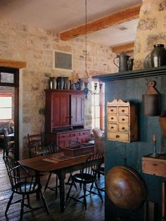 A collection of primitive pottery and farmhouse antiques fills the space.