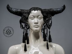Black horned headdress with lace and tassels / Bull horn