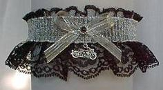Heavy Metal... Silver Chain Mail on Black Lace with a Silver Motorcycle Charm attached. Unexpected rewards for the Biker Bride at her Wedding. For this Motorcycle Garter. #BikerGarter #BikerWedding #MotorcycleGarter - Visit: www.garters.com/page51h.htm