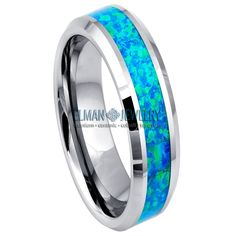 This Ring is made of Tungsten Carbide with Comfort Fit design and is ideal as Contemporary Wedding Ring Band, Engagement Ring, Anniversary Band, Gift for His and Her or just for Everyday Wearing.    The Ring is Lightweight, Bio-compatible and Hypoallergenic. The ring features is 6 mm Tungsten Carbide Ring with Synthetic Opal Inlay.    Features:  - Life-time Guarantee  - Same business day Priority Shipping  - Hypoallergenic & Scratch Resistant    Item Details:  SKU# TR532EL  Style: Fashion… Tungsten Carbide Rings, Anniversary Bands, Wedding Ring Bands, Style Fashion, Opal, Rings For Men, Engagement Rings, Contemporary, Business
