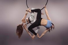 Aerial Hoop/Aerial Lyra doubles. Double Delilah hold on the lower bar.