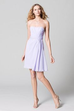 Watters WTOO 392 Violet crystal chiffon strapless asymmetrical draped bodice with shirred waist band and above-the-knee length draped skirt. Dress also offered in floor-length.