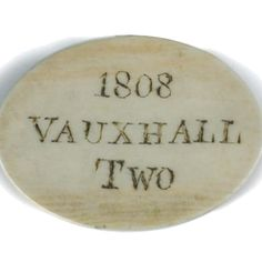 An Ivory Admissions Token to Vauxhall Gardens, 1808, to hear Miss Fearon, the oval token engraved and stained with date and 'Two' denoting the fact that the ticket admitted two people, and 'Miss Fearon' to the reverse w:5.50 cm Provenance: From the collection of the late Christopher Hogwood CBE Miss Fearon (or Feron) was a famous soloist who sang at the Vauxhall Gardens.