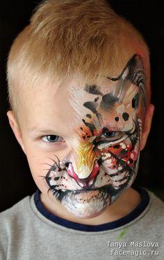 Half-face tiger. Face paint by Tanya Maslova.                                                                                                                                                     More