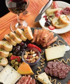 Along with your wine, order the charcuterie platter with chef's choice of three meats, three cheeses, seasonal fruit, olives, mixed nuts and toasted artisan bread.