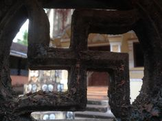 Swastika on the boundary walls of one of the temples in Gokarna